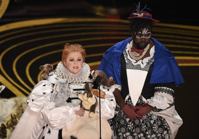 Melissa McCarthy, left, and Brian Tyree Henry present the award for best costume design at the Oscars on Sunday, Feb. (Photo by Chris Pizzello/Invision/AP)