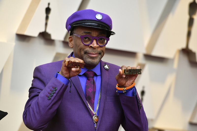 Spike Lee holds up brass knuckles reading