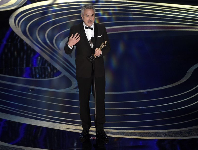 Alfonso Cuaron accepts the award for best cinematography for