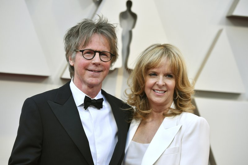 Dana Carvey, left, and Paula Zwagerman arrives at the Oscars on Sunday, Feb. 24, 2019, at the Dolby Theatre in Los Angeles. (Photo by Jordan Strauss/Invision/AP)