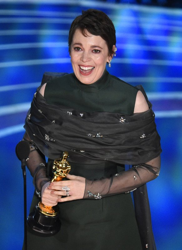 Olivia Colman accepts the award for best performance by an actress in a leading role for