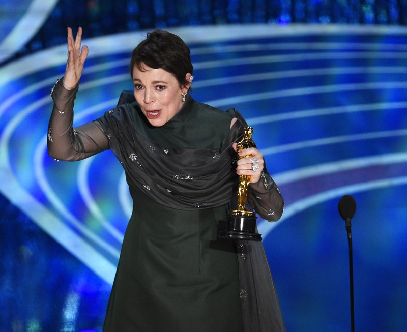 Olivia Colman reacts as she accepts the award for best performance by an actress in a leading role for