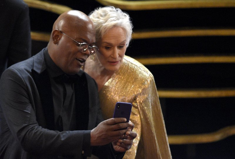 Samuel L. Jackson, left, and Glenn Close take a selfie prior to the start of the Oscars on Sunday, Feb. (Photo by Chris Pizzello/Invision/AP)