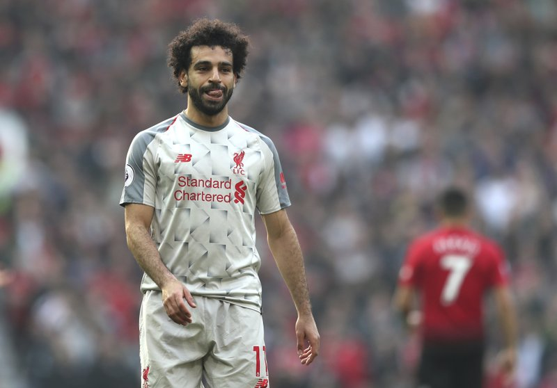 Liverpool's Mohamed Salah during the English Premier League soccer match between Manchester United and Liverpool at Old Trafford stadium in Manchester, England, Sunday, Feb. (AP Photo/Jon Super)