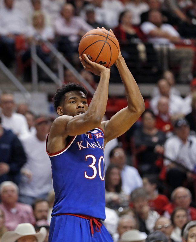 Kansas' Ochai Agbaji (30) shoots during the second half of the team's NCAA college basketball game against Texas Tech, Saturday, Feb. (AP Photo/Brad Tollefson)