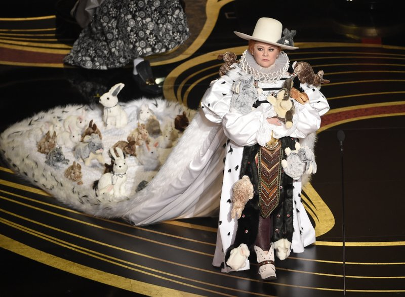 Melissa McCarthy walks on stage to present the award for best costume design at the Oscars on Sunday, Feb. (Photo by Chris Pizzello/Invision/AP)