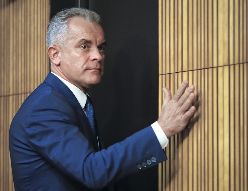 Vladimir Plahotniuc, the leader of the Democratic Party, leaves after giving a press statement in Chisinau, Moldova, Sunday, Feb. (AP Photo/Vadim Ghirda)