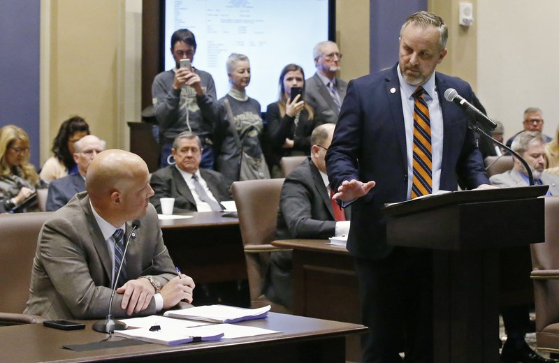 Oklahoma state Senator Joseph Silk, R-Broken Bow, left, debates with Oklahoma state Sen. Greg Treat, R- Oklahoma City, President Pro Tempore, right, on the best way to ban abortion in Oklahoma during a Senate committee meeting Monday, Feb. (AP Photo/Sue Ogrocki)