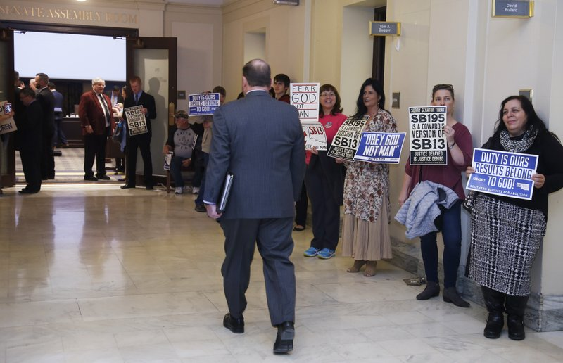 Anti-abortion protestors line the hallway to a Senate committee meeting room where an anti-abortion measure is schedule to be discussed Monday, Feb. (AP Photo/Sue Ogrocki)