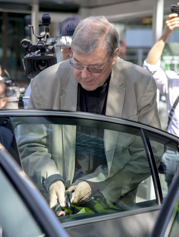 In this Friday, Feb. 22, 2019, photo, Cardinal George Pell leaves the County Court in Melbourne, Australia. (AP Photo/Andy Brownbill)