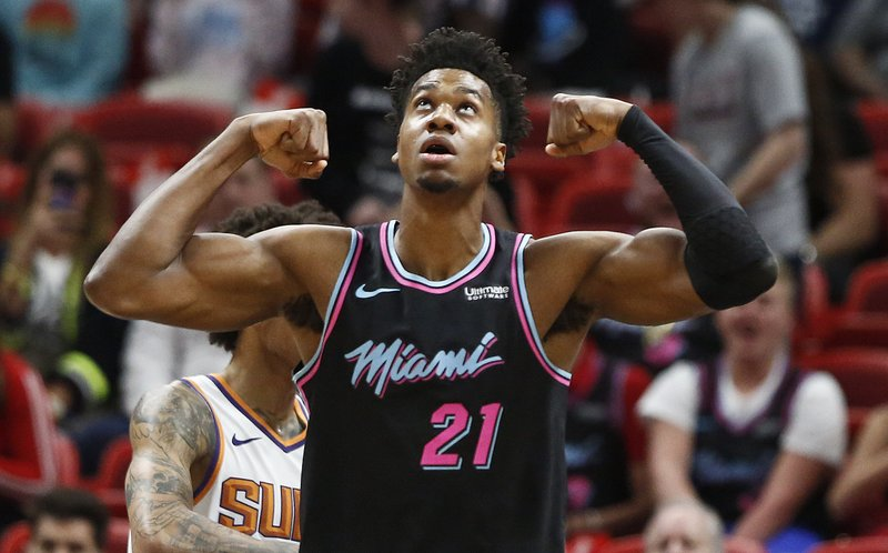 Miami Heat center Hassan Whiteside (21) celebrates after scoring during the first half of an NBA basketball game against the Phoenix Suns on Monday, Feb. (AP Photo/Brynn Anderson)