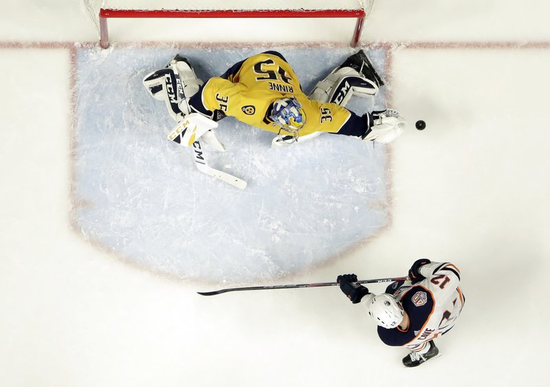 Nashville Predators goaltender Pekka Rinne (35), of Finland, reaches for a shot as Edmonton Oilers center Colby Cave (12) watches for a rebound in the second period of an NHL hockey game Monday, Feb. (AP Photo/Mark Humphrey)