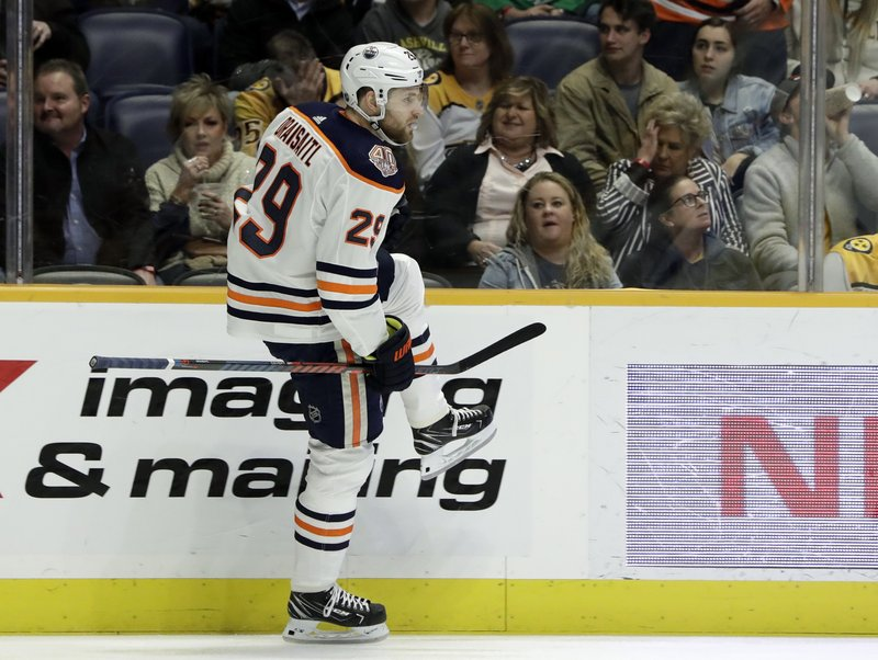 Edmonton Oilers center Leon Draisaitl, of Germany, celebrates after scoring a goal against the Nashville Predators in the first period of an NHL hockey game Monday, Feb. (AP Photo/Mark Humphrey)
