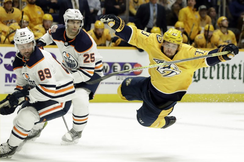 Nashville Predators left wing Viktor Arvidsson (33), of Sweden, falls after being tripped by Edmonton Oilers defenseman Sam Gagner (89) in the second period of an NHL hockey game Monday, Feb. (AP Photo/Mark Humphrey)