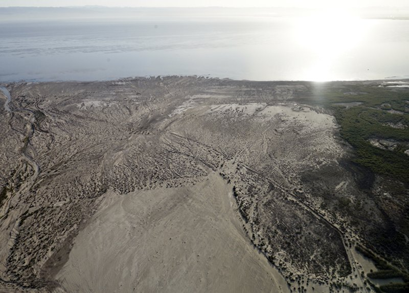 FILE - This May 1, 2015 photo shows the exposed, fried lakebed of the Salton Seanear Niland, Calif. Work on a multistate plan to address drought on the Colorado River in the U. (AP Photo/Gregory Bull, File)