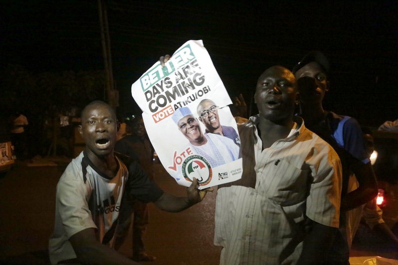 Supporters of Leading opposition candidate, Atiku Abubakar, celebrate the announcement of results favoring his People's Democratic Party (PDP) party in their state, anticipating victory, in Yola, Nigeria Monday, Feb. (AP Photo/Sunday Alamba)