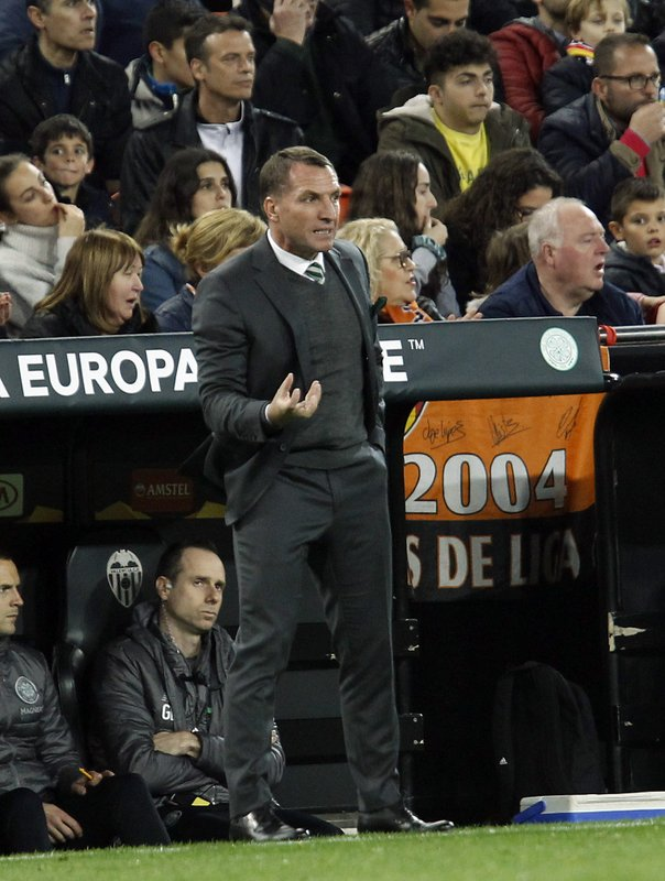 Celtic coach Brendan Rodgers gestures to players during their Europa League round of 32, second leg, soccer match between Valencia and Celtic at the Mestalla stadium in Valencia, Spain, Thursday, Feb. (AP Photo/Alberto Saiz)