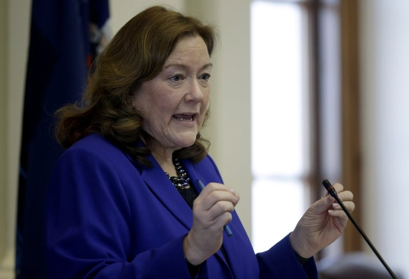 Chief Justice Leigh Saufley delivers her annual state of the judiciary address to a joint convention of the Legislature, Tuesday, Feb. (AP Photo/Robert F. Bukaty)