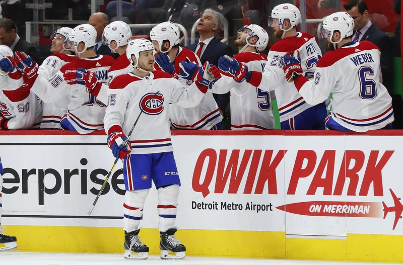 Montreal Canadiens' Andrew Shaw (65) celebrates his goal against the Detroit Red Wings in the second period of an NHL hockey game, Tuesday, Feb. (AP Photo/Paul Sancya)