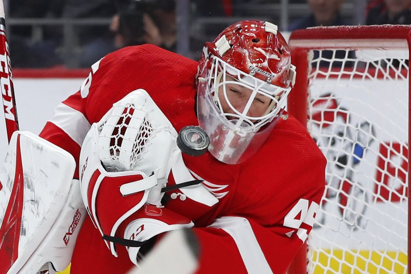 Detroit Red Wings goaltender Jonathan Bernier (45) stops a shot off his mask against the Montreal Canadiens in the third period of an NHL hockey game, Tuesday, Feb. (AP Photo/Paul Sancya)