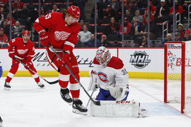 Detroit Red Wings left wing Tyler Bertuzzi (59) jumps in front of Montreal Canadiens goaltender Carey Price (31) who stopped the shot in the second period of an NHL hockey game, Tuesday, Feb. (AP Photo/Paul Sancya)