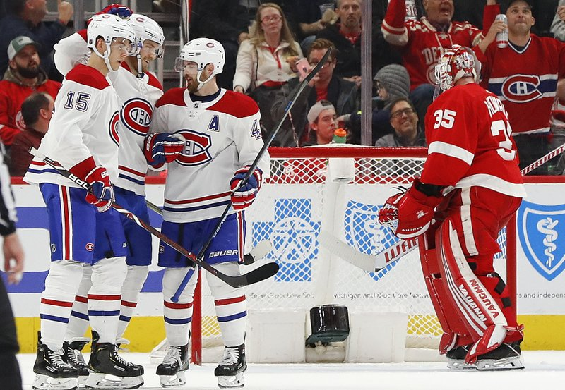 Montreal Canadiens right wing Joel Armia, second from left, celebrates his goal against the Detroit Red Wings in the second period of an NHL hockey game, Tuesday, Feb. (AP Photo/Paul Sancya)