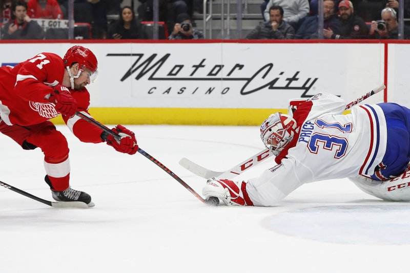 Montreal Canadiens goaltender Carey Price (31) stops a Detroit Red Wings center Dylan Larkin (71) shot in the second period of an NHL hockey game, Tuesday, Feb. (AP Photo/Paul Sancya)