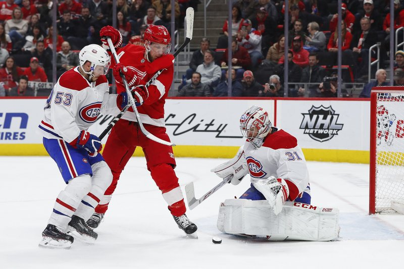 Montreal Canadiens goaltender Carey Price (31) stops a shot as Victor Mete (53) and Detroit Red Wings left wing Justin Abdelkader (8) battle for the rebound in the second period of an NHL hockey game, Tuesday, Feb. (AP Photo/Paul Sancya)