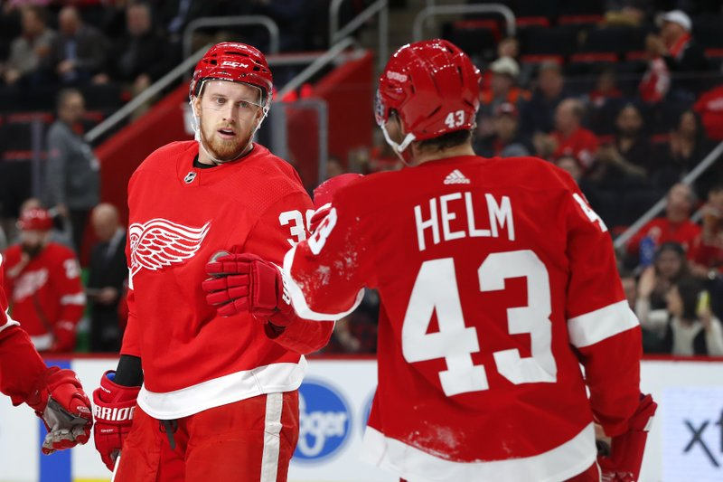 Detroit Red Wings right wing Anthony Mantha (39) celebrates his goal against the Montreal Canadiens with Darren Helm (43) in the second period of an NHL hockey game, Tuesday, Feb. (AP Photo/Paul Sancya)