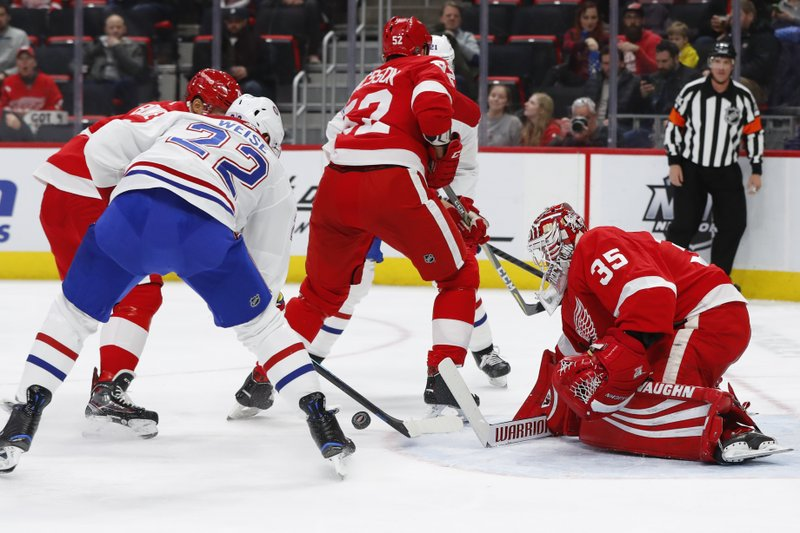 Detroit Red Wings goaltender Jimmy Howard (35) stops a Montreal Canadiens right wing Dale Weise (22) shot in the first period of an NHL hockey game, Tuesday, Feb. (AP Photo/Paul Sancya)