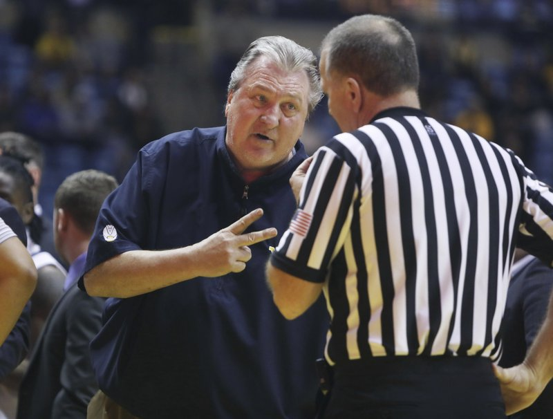 West Virginia head coach Bob Huggins yells at a referee during the second half of an NCAA college basketball game against TCU Tuesday, Feb. (AP Photo/Raymond Thompson)