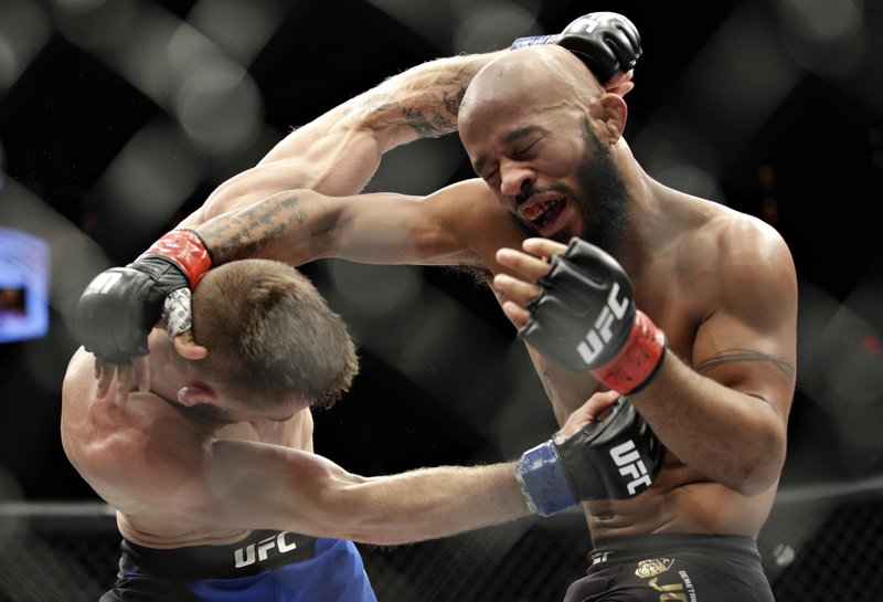File- This Dec. 3, 2016, file photo shows Demetrious Johnson, right, fighting Tim Elliott during a mixed martial arts flyweight bout, in Las Vegas. (AP Photo/John Locher, File)