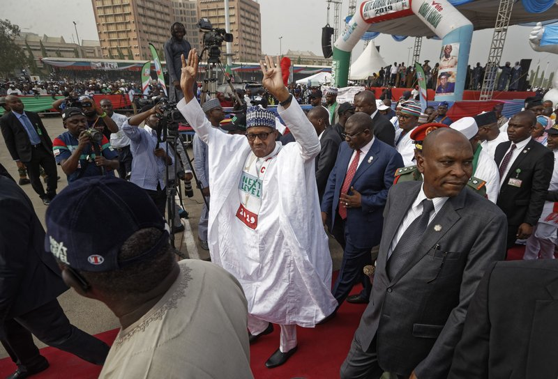 FILE - In this Wednesday, Feb. 13, 2019 file photo, incumbent President Muhammadu Buhari gestures to supporters at a campaign rally in Abuja, Nigeria. (AP Photo/Ben Curtis, File)