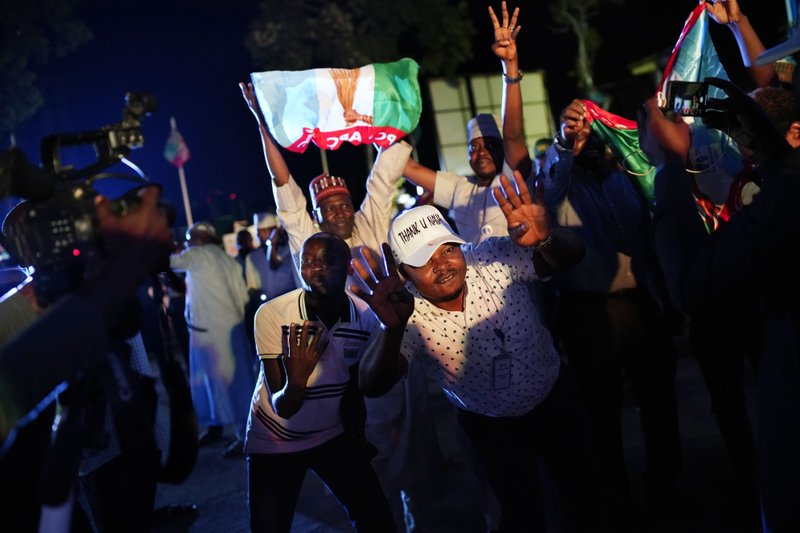 Supporters of Incumbent President Muhammadu Buhari dance to Lady Gaga songs anticipating a win as they wait for the results to be officially announced in Abuja, Nigeria, Tuesday, Feb. (AP Photo/Jerome Delay)