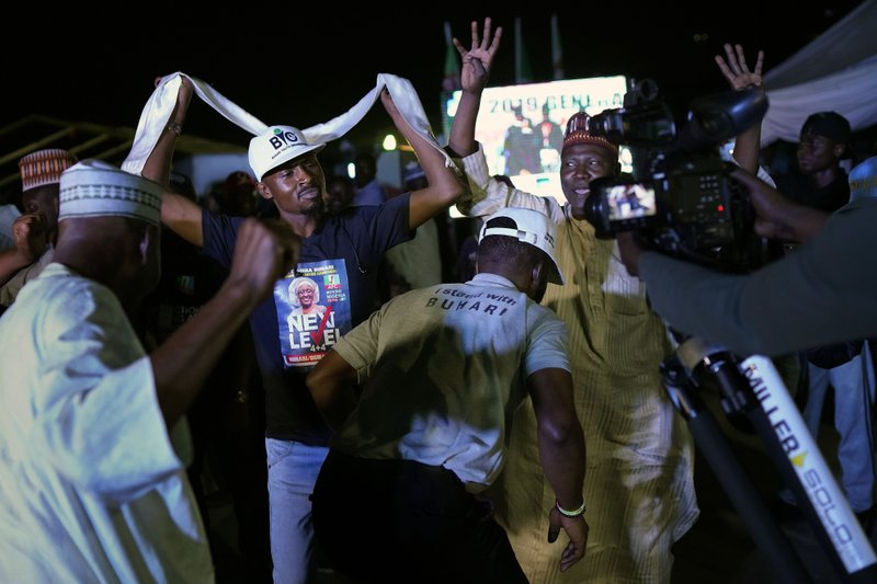 Supporters of Incumbent President Muhammadu Buhari party anticipating a win as they wait for the results to be officially announced in Abuja, Nigeria, Tuesday, Feb. (AP Photo/Jerome Delay)