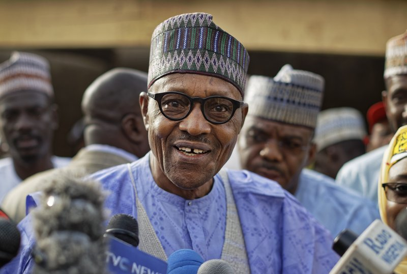 FILE - In this Saturday, Feb. 23, 2019 file photo, Nigeria's President Muhammadu Buhari speaks to the media after casting his vote in his hometown of Daura, in northern Nigeria. (AP Photo/Ben Curtis, File)
