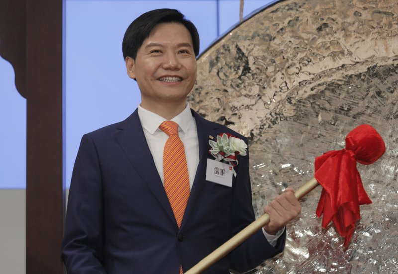 FILE - In this July 9, 2018, file photo, Xiaomi's Founder, Chairman and CEO Lei Jun smiles after he hits the gong during the listing ceremony at the Hong Kong Stock Exchange in Hong Kong. (AP Photo/Vincent Yu, File)