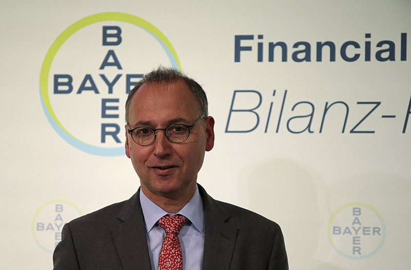 Werner Baumann, CEO of the Bayer AG company arrives for the annual press conference in Leverkusen, Germany, Wednesday, Feb. ( Oliver Berg/dpa via AP)