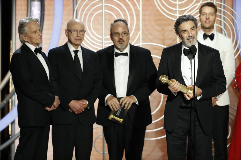 FILE - This Jan. 6, 2019, file image originally released by NBC shows Chuck Lorre, foreground right, accepting the award for best TV comedy series for Netflix's