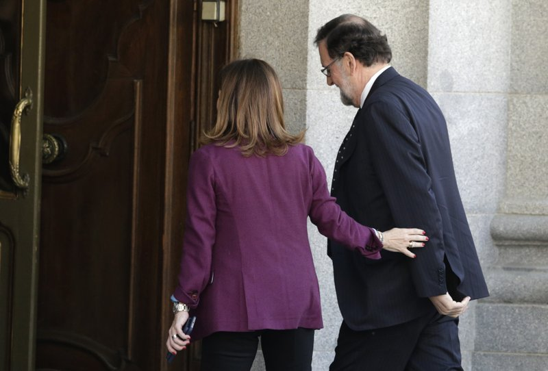 Former Spanish Prime Minister Mariano Rajoy arrives at the court to the testify in the ongoing trial of Catalan separatists in Madrid, Spain, Wednesday, Feb. (AP Photo/Andrea Comas)