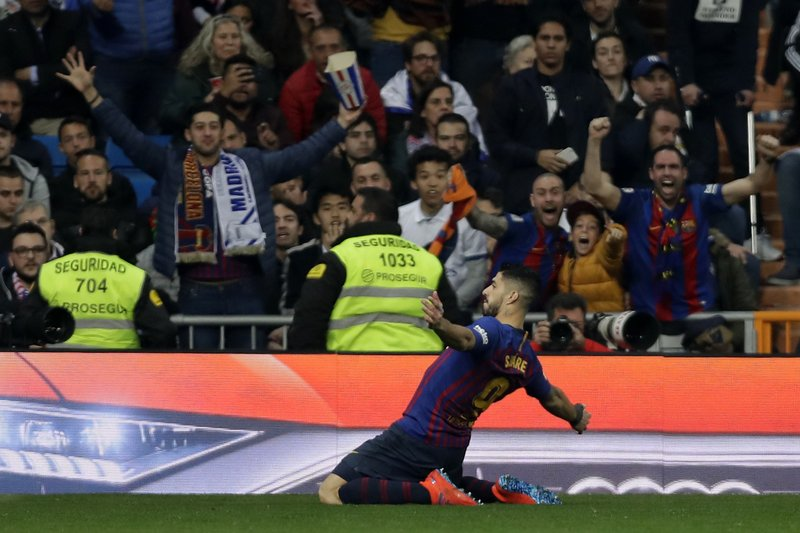 Barcelona forward Luis Suarez celebrates after scoring the opening goal of his team during the Copa del Rey semifinal second leg soccer match between Real Madrid and FC Barcelona at the Bernabeu stadium in Madrid, Wednesday, Feb. (AP Photo/Manu Fernandez)