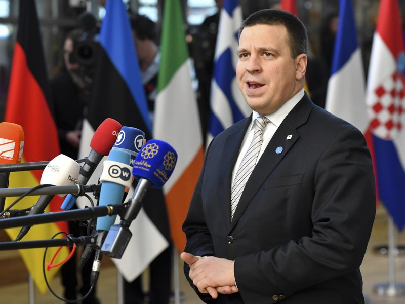 FILE - In this file photo taken on Thursday, Dec. 13, 2018, Estonian Prime Minister Juri Ratas speaks with the media as he arrives for an EU summit in Brussels. (AP Photo/Geert Vanden Wijngaert, File)