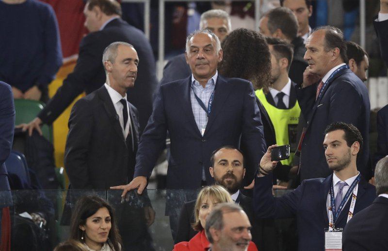 FILE - In this Wednesday, May 2, 2018 file photo, Roma club president James Pallotta, center, looks down from the stands during the Champions League semifinal second leg soccer match between Roma and Liverpool at the Olympic Stadium in Rome. (AP Photo/Alessandra Tarantino, File)