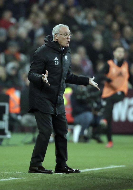 Fulham manager Claudio Ranieri gestures during the English Premier League soccer match between West Ham and Fulham at the London Stadium in London, Friday, Feb. (AP Photo/Matt Dunham)