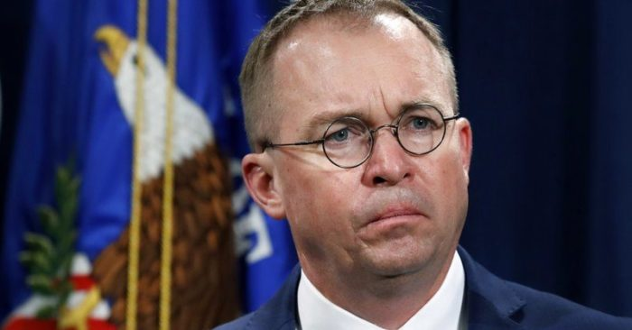 Mick Mulvaney, acting director of the Consumer Financial Protection Bureau (CFPB), and Director of the Office of Management, listens during a news conference at the Department of Justice in Washington. White House Acting Chief of Staff Mick Mulvaney isn't setting any lofty goals for this weekend's meeting with a bipartisan mix of legislators at Camp David, but he is trying to build relationships across the aisle. (AP Photo/Jacquelyn Martin, File)