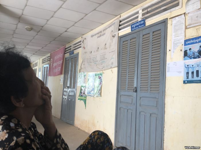 A woman sits in front of delivery room at Mesor Thngork health center where P