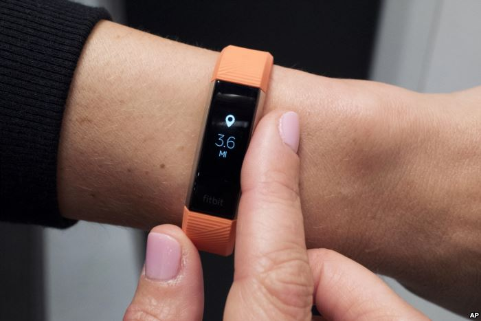 FILE - Fitbit's new Alta HR device is displayed in New York, March 1, 201