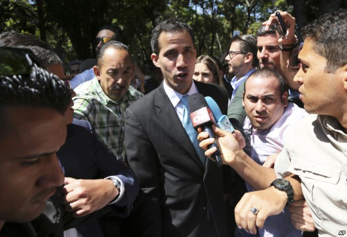 FILE - Opposition National Assembly President Juan Guaido talks with reporter
