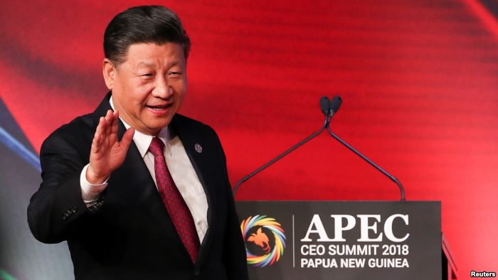 FILE- President of China Xi Jinping arrives for the APEC CEO Summit 2018 at P