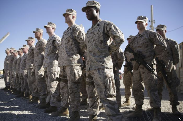 FILE - U.S. Marines stand guard during a change-of-command ceremony at Task F
